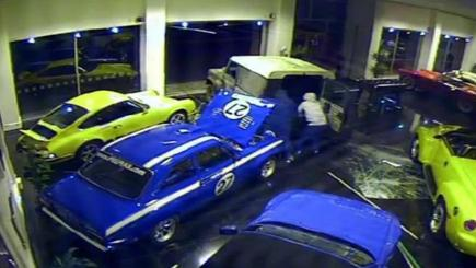 Footage has been released of ram-raiders stealing a £120,000 vintage racing car using a 4x4 - in the space of 60 seconds
