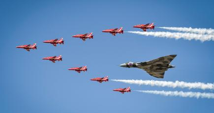 Red Arrows and Vulcan bomber flying in formation