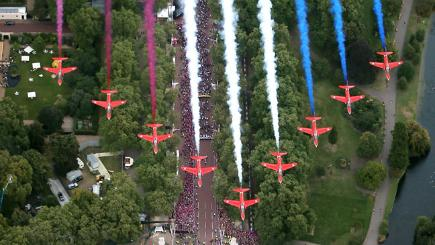 Red Arrows Royal Air Force Aerobatic Team fly in formation over the Queen Victoria Memorial next to Buckingham Palace