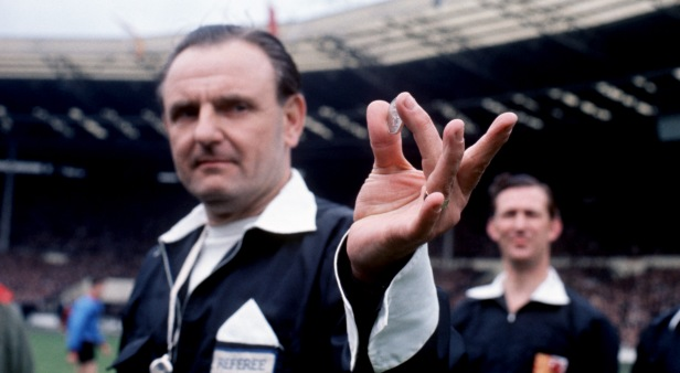 Referee George McCabe shows off the first 50p ahead of the FA Cup Final coin toss