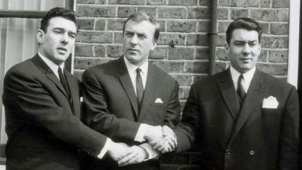 Reginald Kray, Charlie Kray and Ronald Kray (left to right) outside their home in Bethnal Green after Reggie and Ronnie were acquitted of attempting to obtain protection money from a Soho club owner, 1965