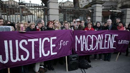 Relatives of victims of the Magdalene Laundries hold a candle lit vigil in 2013