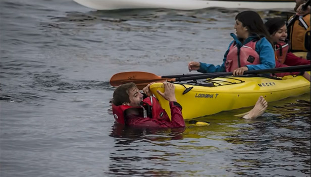 Tom Mustill and Charlotte Kinloch are rescued from the waters by fellow kayakers.