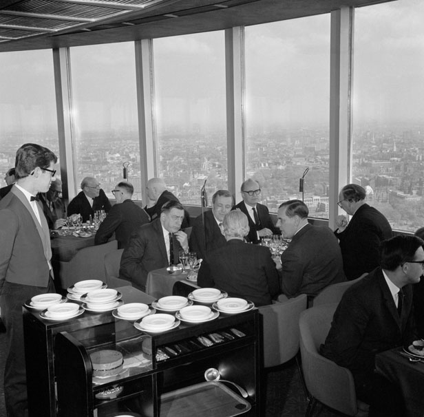 Diners eat at Top of the Tower, the revolving restaurant on the 34th floor of the tower.