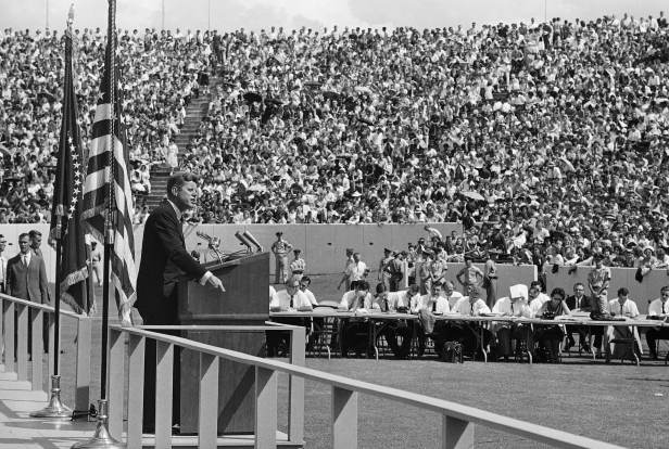 Kennedy delivers an address to approximately 50,000 people at Rice University stadium in Houston in September 1962. The President promised that outer space will not be filled with weapons of mass destruction.