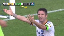 Robbie Keane tries to blame a flying loo roll for this missed chance