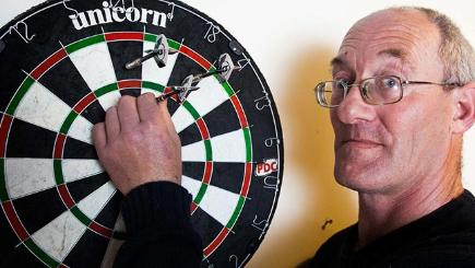 Blind darts player investigated over benefit fraud