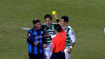 Ronaldinho receives the yellow card