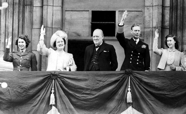 Winston Churchill joins the Royal Family to greet the crowds from the balcony of Buckingham Palace.