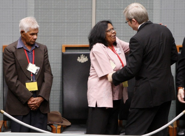 Prime Minister Kevin Rudd greets members of Australia's Stolen Generation in the public gallery after delivering a speech where he apologized to its indigenous people for past treatment in February 2008.