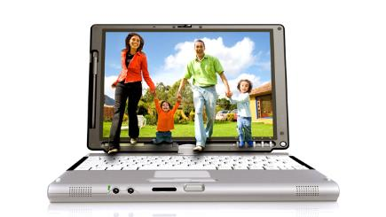 Laptop with family on screen holding hands