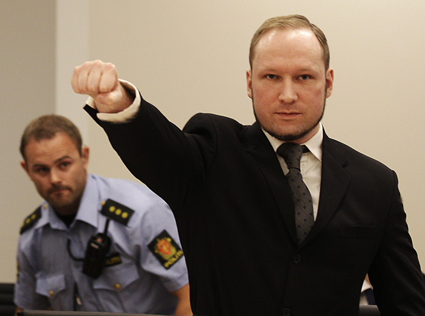 Anders Behring makes a salute after arriving in the court room in Oslo in August 2012.