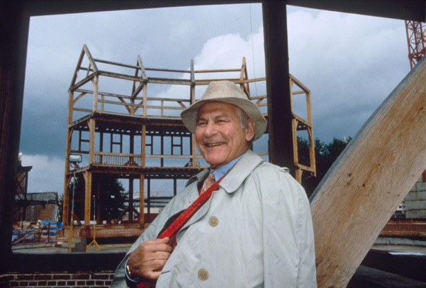 Sam Wanamaker, the man who dreamt of rebuilding the Globe, as the building started to take shape.