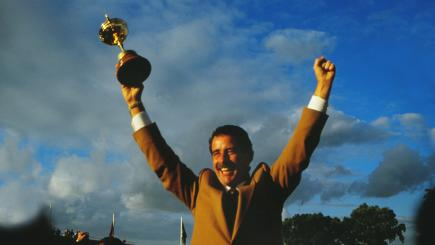Sam Torrance holds the Ryder Cup aloft after holing the winning putt.