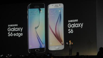 Hands holding up two phones - Samsung S6 and S6 edge