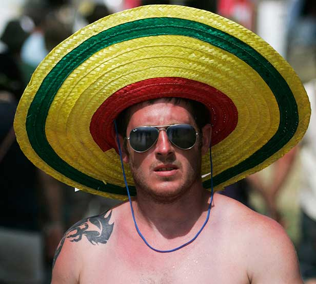 Festival-goers enjoy scorching sunshine at the 2010 Glastonbury Festival