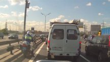 Screengrab from CEN video of a Moscow traffic policeman being knocked off his bike by a careless motorist.