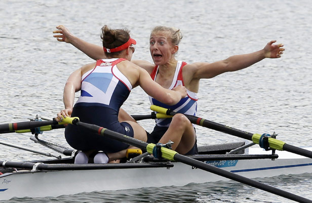 Sophie Hosking and Katherine Copeland celebrate after winning gold in the lightweight double sculls.