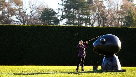 A member of staff cleans a sculpture at the Yorkshire Sculpture Park, near Wakefield