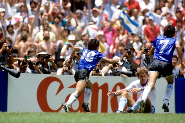 Maradona celebrates his second goal against England, whose Terry Butcher sits on the ground in despair.
