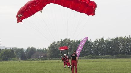 D-Day veteran Fred Glover, 90, lands after a tandem parachute jump at Salisbury's Old Sarum Airfield