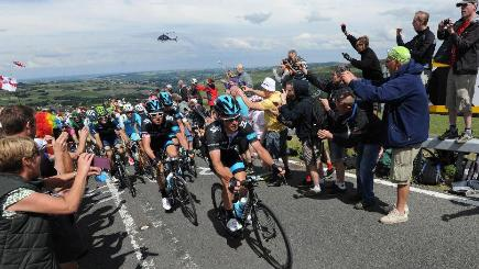 Tour de France riders have urged spectators to keep their distance