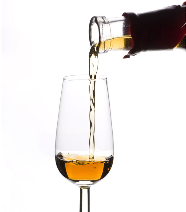Sherry should be served at room temperature in a small glass