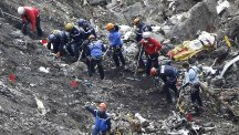 Rescue workers inspect debris from the Germanwings jet at the crash site near Seyne-les-Alpes (AP)