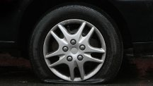 Stock image of a flat tyre on a car