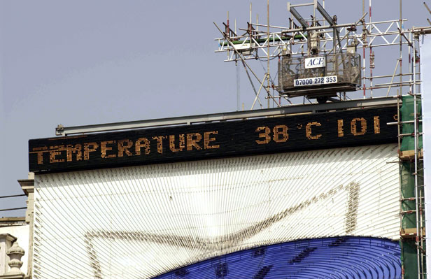 The electronic display in Piccadilly Circus shows the mercury reaching 38 degrees.