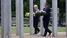 London mayor Boris Johnson and Prime Minister David Cameron lay wreathes at the July 7 memorial in Hyde Park, London