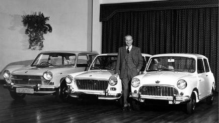 Sir Alec Issigonis with three Austin cars