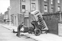 Siting a K6 red telephone kiosk in the street. 1951.