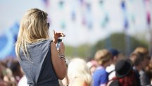 Woman at festival with phone