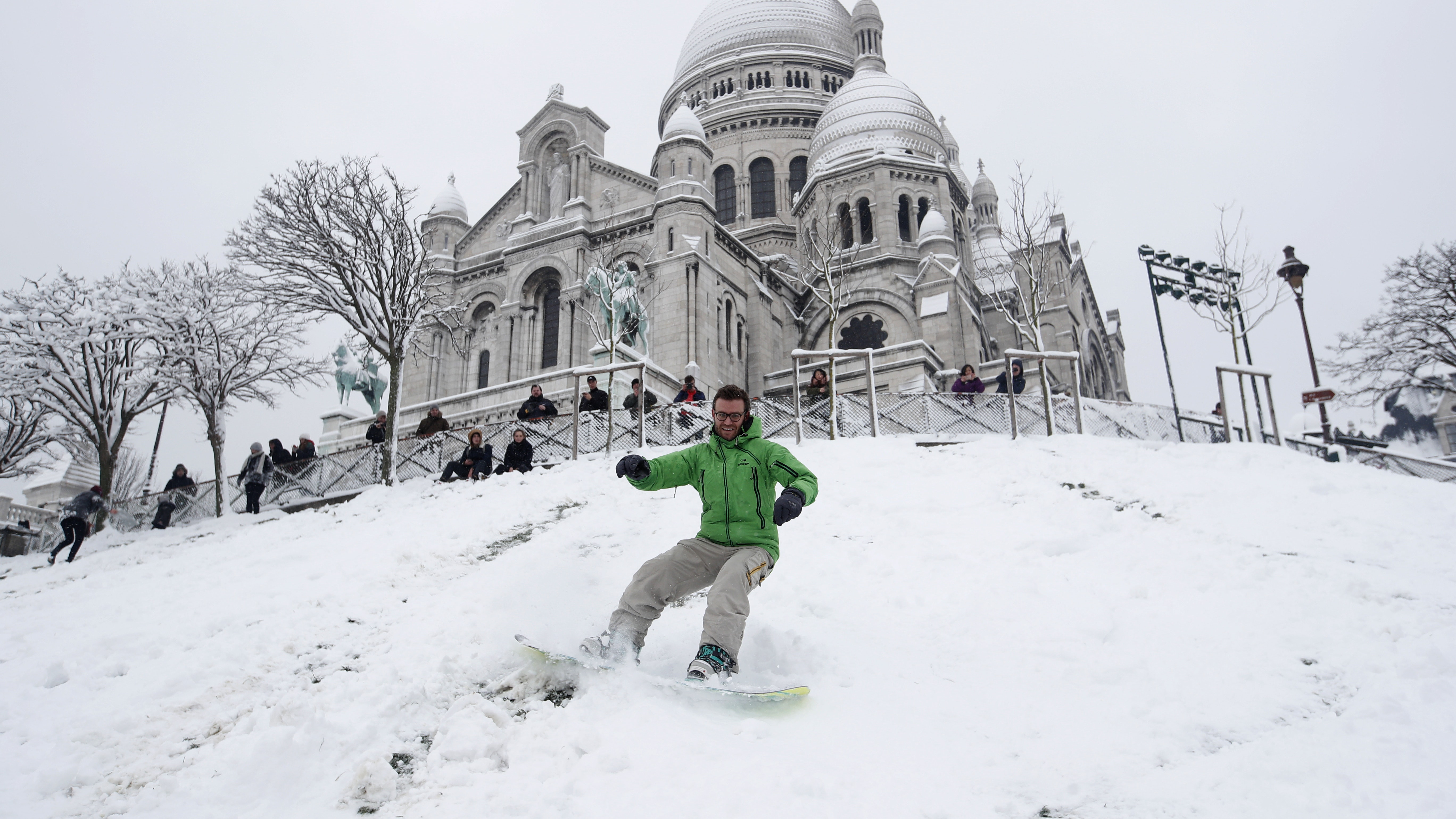Eiffel Tower closed as heavy snowfall blankets Paris