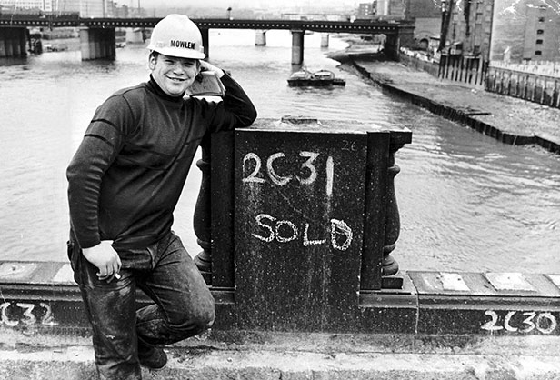 17-year-old Alan Saines numbering some of the 10,000 granite blocks as the bridge is being dismantled.