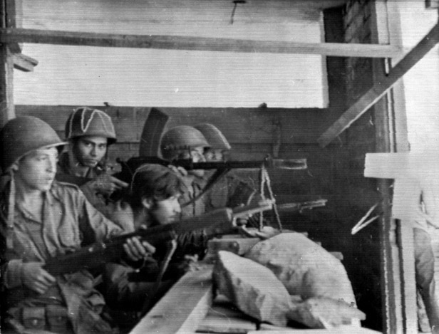 Salvadorean soldiers point their machine guns towards Honduras, at a frontier post near El Poy, El Salvador on July 15, 1969.
