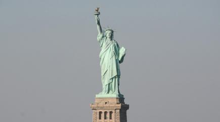'Refugees Welcome' banner illegally placed on Statue of Liberty