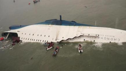 Rescue team boats and fishing boats search for passengers on a ferry sinking off South Korea's southern coast (South Korea Coast Guard/AP)