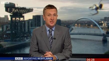 A spider 'photobombed' the Reporting Scotland broadcast (BBC News Scotland/PA Wire)