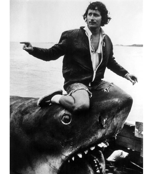 Director Steven Spielberg hitches a ride on one of the mechanical sharks - dubbed Bruce - used in the filming.