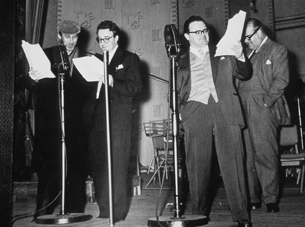 Milligan, Sellers and Secombe with announcer Wallace Greenslade in 1958.