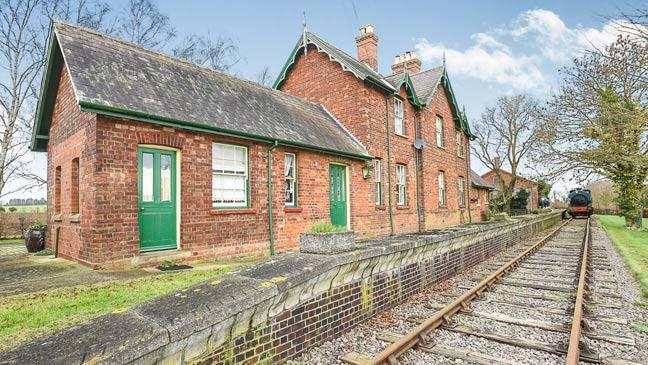 Converted railway station for sale - and it comes with its own train