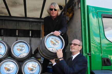 Rick Parfitt, left, and Francis Rossi of Status Quo with barrels of their own beer, Piledriver
