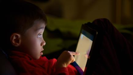 Boy using tablet looking scared