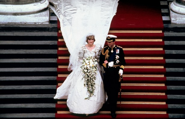 Charles and Diana, wearing a dress designed by Elizabeth and David Emmanuel, walk down the steps of St Paul's after the ceremony.