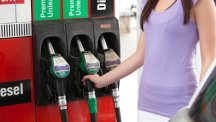Stock image of a woman at a petrol pump