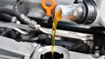 Stock image of oil being poured into a car engine