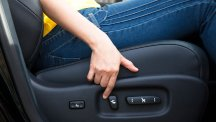 Stock image of person adjusting their driving seat