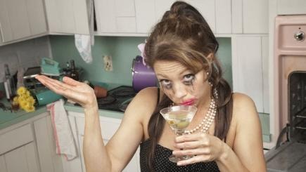 Stock image of woman with a cocktail and smudged eye make-up.